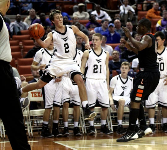 Water Valley High School's Kellan Kirkland saves the ball from going out of bounds during the Class 1A Division II state championship win over Laneville at the Frank Erwin Center in Austin on March 8, 2014.