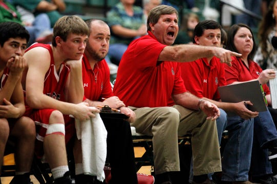 Ballinger High School head basketball coach Robert Buxkemper shouts plays from the bench in a game against Grape Creek on Jan. 20, 2012.