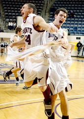 Bronte High School's Terron Charles (left) and Dakota Rawls celebrate their 62-58 victory over Italy in the Region II-1A final March 6, 2010.