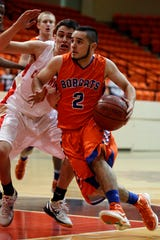Central High School's Adrian Neira makes a move to the basket in an area playoff game against Lubbock Coronado in Big Spring on Feb. 24, 2012.