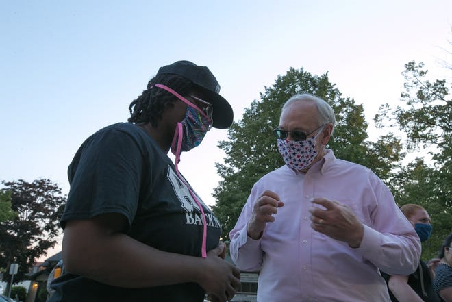 Sheboygan Mayor Mike Vandersteen, right, wears a mask while talking with Cowa Whelie at a Black Lives Matter protest on June 18 in Sheboygan.