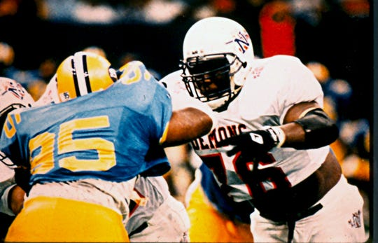 Former Northwestern State great Marcus Spears (right) in action against Southern.