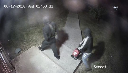 Police are seeking suspects for an alleged arson at the Community OutPost building early morning Wednesday, June 17, 2020.