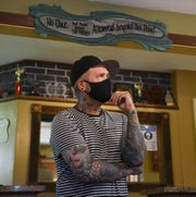 Scotty Munster, owner of Olde Town Tattoo, speaks about changes to business Thursday, June 18, 2020, in St. Cloud.