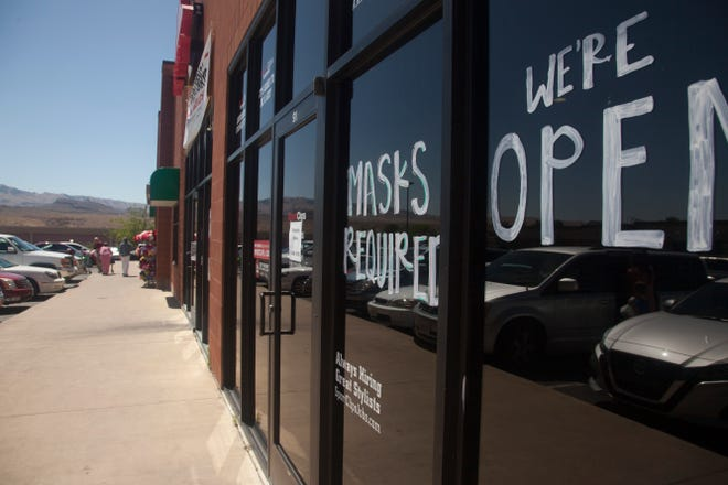 SportClips posts mask requirement signage on the front of their stores Thursday, June 18, 2020.