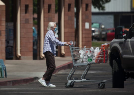 As COVID-19 restrictions ease local shoppers are still seen wearing masks while shopping Thursday, June 18, 2020.