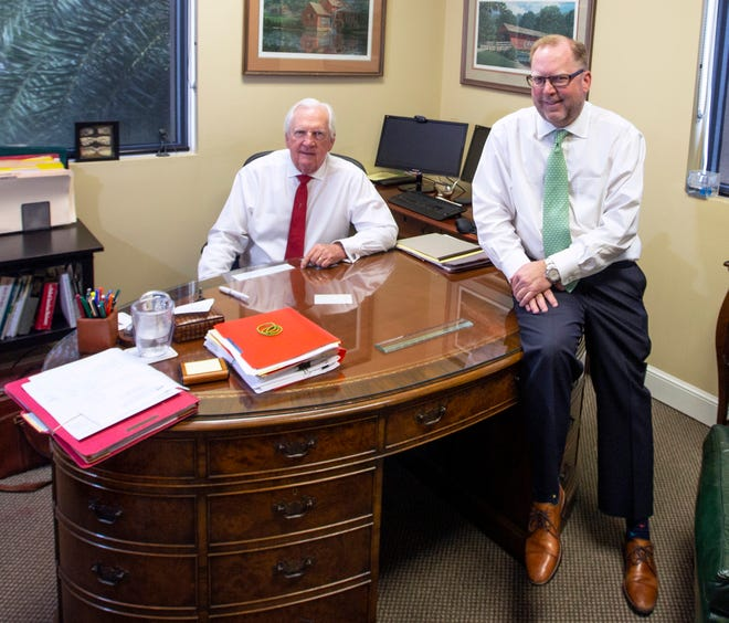 Incoming 2019 Florida Bar president John Stewart, right, with his father, William J. Stewart, in the elder Stewart's office at Rossway Swan in Vero Beach.