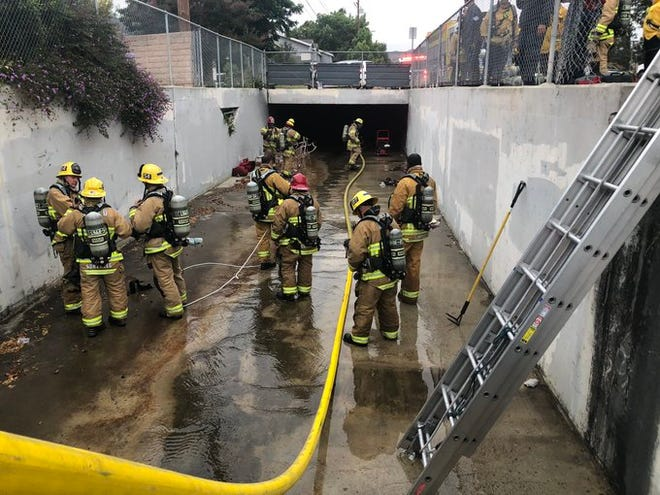 This was the scene of a fire burning inside a drain tunnel along Steckel Drive in Santa Paula on Thursday evening.