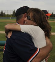 College of the Sequoias baseball coach Jody Allen gets a hug from his wife, Lisa, after recording his 424th win as College of the Sequoias head baseball coach against Reedley College on March 20, 2010.
