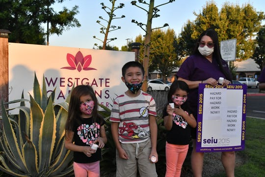 Westgate Gardens Care Center staff held a vigil at the nursing home, calling for boosted pay and better treatment during the coronavirus pandemic.
