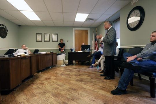 Zanesville Mayor Don Mason talks to the members of the land bank about the city's bid for the former Lear property on Linden Avenue. The city was the only bidder on the property with a bid of $28,000, the minimum amount set by the land bank.