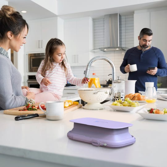 The UV-Clean Phone Sanitizer, shown here in a kitchen setting, can zap smartphones clean using powerful ultraviolet light.