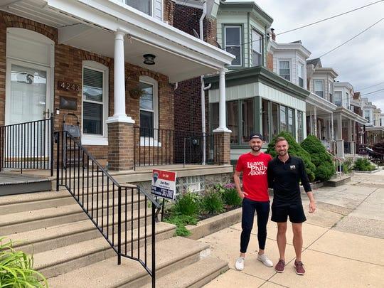 Andrew Harmon, left, with his fiance, Evan Garbayo, right.