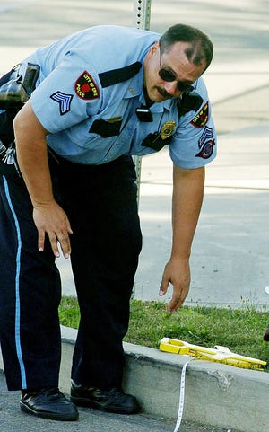 This is an August 2006 file photo of then-Cpl. Jeff Annunziata of the Erie Bureau of Police on the scene of a traffic accident in Erie, Pennsylvania.