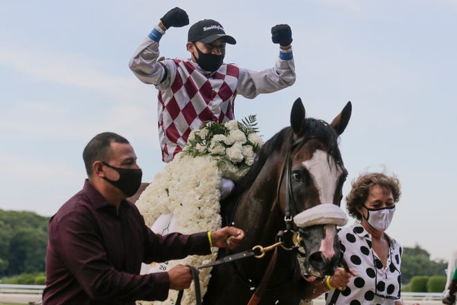 Jockey Manny Franco reacts after winning the 152nd running of the Belmont Stakes horse race atop Tiz the Law on Saturday. SETH WENIG/AP