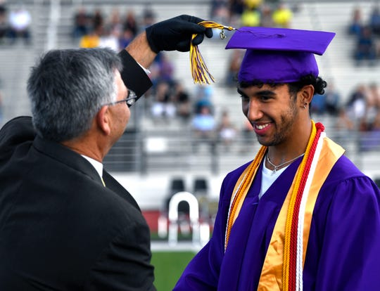 Wylie Independent School District Superintendent Joey Light ceremoniously moves graduating senior Payton Brooks' tassel over the left during Saturday's commencement.