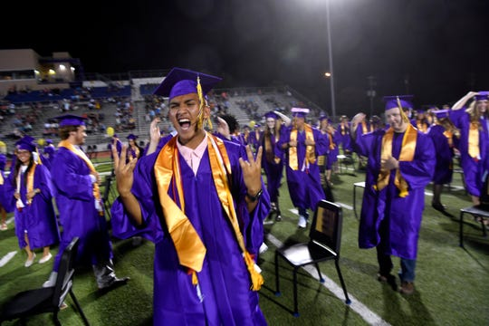 Wylie High School senior Christian Merced expresses his feelings after Friday's graduation was halted midway through because of an incoming thunderstorm. Students and faculty retreated to the Doghouse athletic building as torrential rain and high winds ended the ceremony for the evening. Some graduates elected to receive their diplomas in the Doghouse, while others chose to reconvene Saturday morning for the rest of their graduation ceremony.