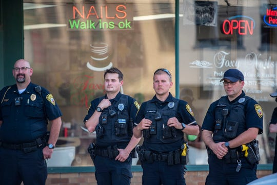 Albion public safety officers watch a Black Lives Matter rally on Friday, June 19, 2020 in downtown Albion, Mich. The demonstration took place on Juneteenth, the day in which enslaved people in Texas learned they were free in 1865.