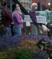 People gathered for a Juneteenth candlelight vigil outside of the Marvin Williams Center in Bremerton on Friday, June 19, 2020. The event began at 8:46 p.m. with 8 minutes and 46 seconds of silence – the length of time that Minneapolis police officer Derek Chauvin knelt on Floyd's neck while he pleaded that he couldn't breathe. The vigil memorialized the lives of Floyd, Breonna Taylor, Ahmaud Arbery and other Black people killed by the police.