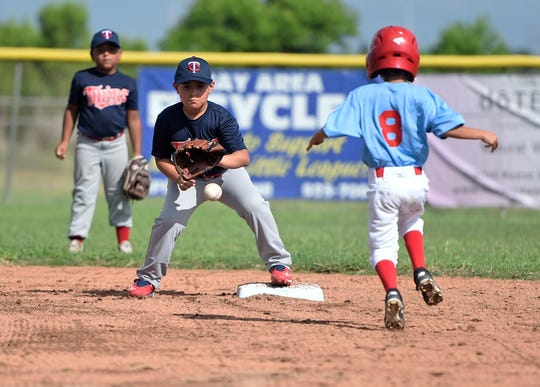 Seven-year-old Jared Daniel Ramon prepares to catch the ball at second base, Saturday, June 20, 2020, at the Paul Jones Avenue Sports Complex. Ramon is from Robstown.