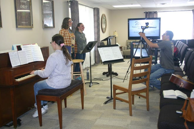 The Abbott family of Otsego - Anneliese Abbott (left) Elizabeth Abbott, Laura Abbott and Tim Abbott - perform and stream church hymns during the novel coronavirus pandemic. The family started streaming the music for the First Baptist Church of Otsego's Sunday services while in-person services were placed on hiatus from March to June 2020.