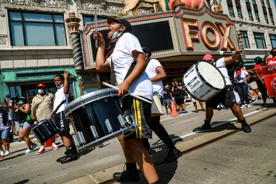Students from Cass Technical high school that are apart of the Music Project Drum Line march with the Juneteenth BLM March that will start in front of Fox Theater on Woodward Avenue on Saturday, June 20, 2020.
