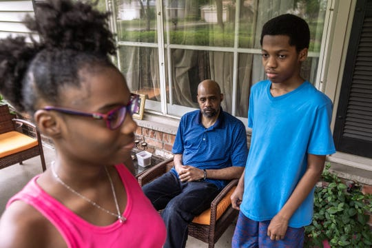 Darren Nichols sits with his children Caleb and Laila at their home in Southfield on  June 19, 2020. Nichols has had to have the conversation with his children of being Black in America.