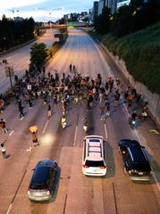 Protesters block the northbound lanes of Interstate 5, Thursday, in downtown Seattle