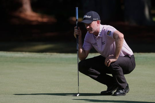 Webb Simpson lines up his putt on the first green Friday during the second round of the RBC Heritage golf tournament in Hilton Head Island, S.C.