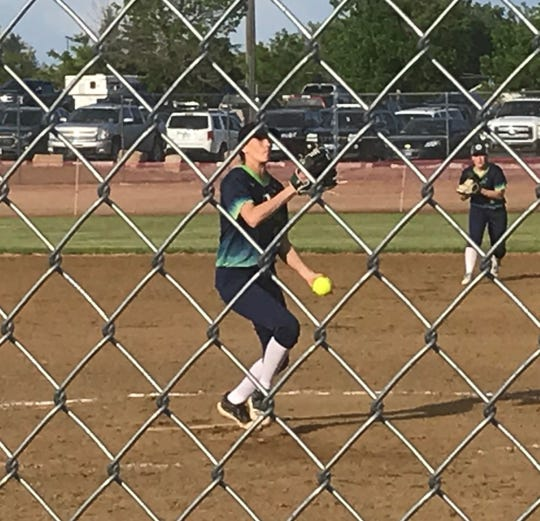 Former C.M. Russell southpaw Madi Moore prepares to fire one toward the plate for Falls Fusion U18 team in their first tournament game against Havre Friday at Multi Sports.