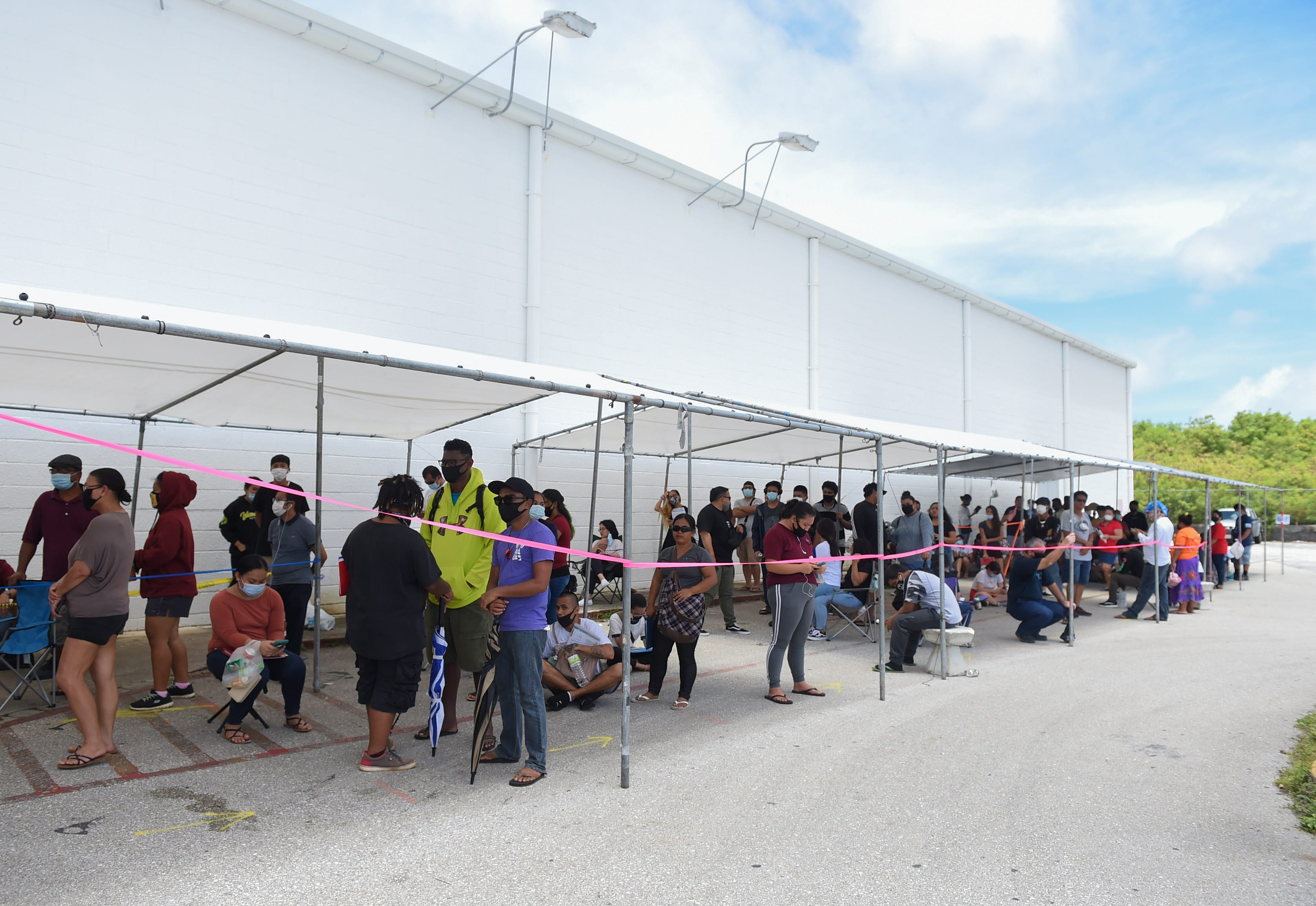 Lines for driver's licenses form during a Saturday opening for the Guam Department of Revenue and Taxation in Barrigada, June 20, 2020.