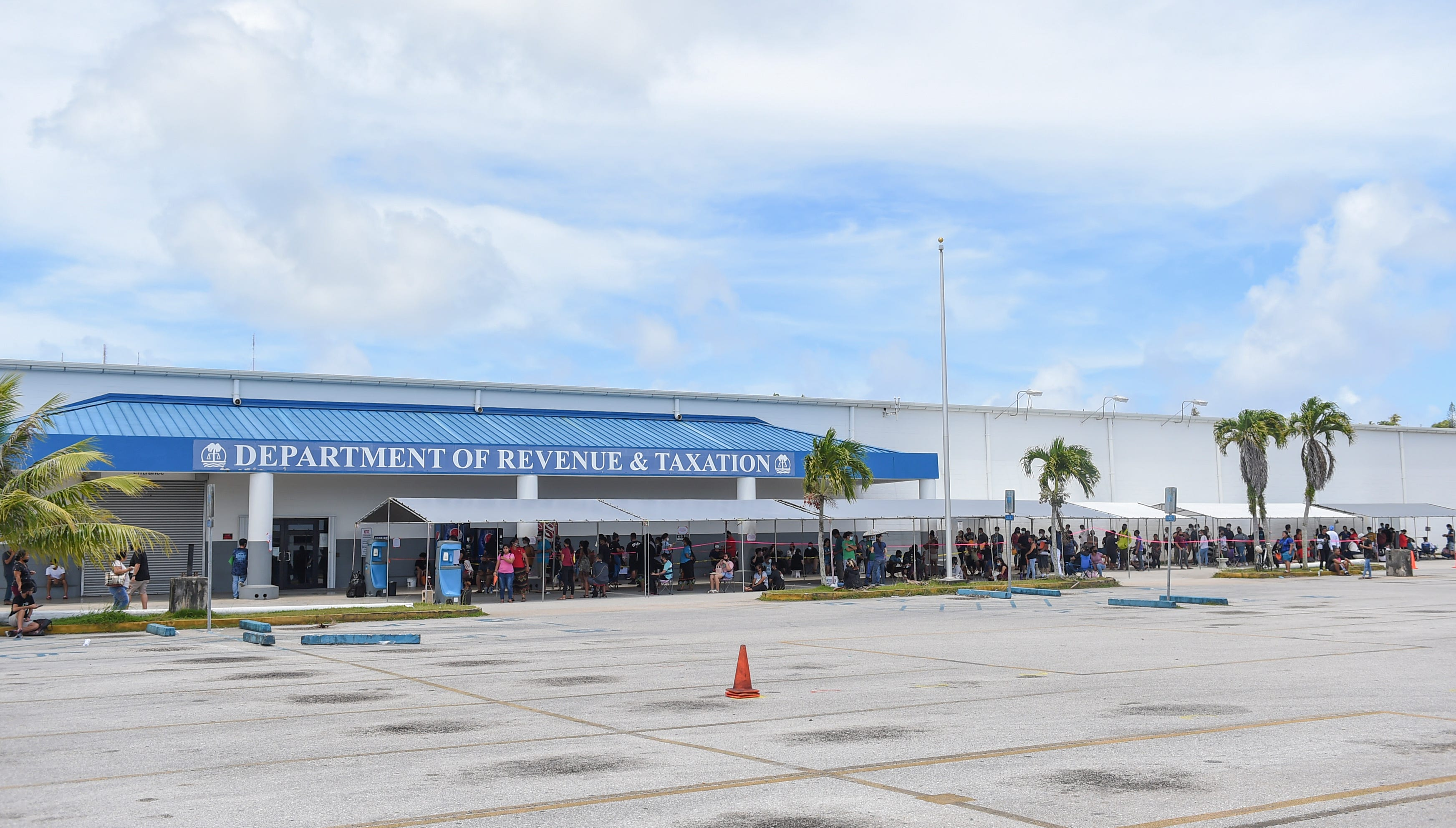 Lines for driver's licenses form during a Saturday opening for the Guam Department of Revenue and Taxation in Barrigada in this June 20 file photo.