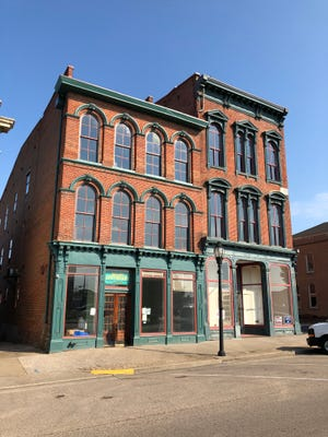 The future of the former Frank G. Schmitt building at 213 N. Main St. has been secured by rehabilitation and renovation of the historic but long-vacant structure into what will become Butler Apothecary in the three-story building at left. New owner Chris Butler is still contemplating what to do with the William Soaper Building at right.