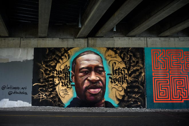 A mural of George Floyd is on display under I-496 along the Lansing River Trail on Friday, June 19, 2020, in Lansing. Floyd was killed after a Minneapolis police officer kneeled on Floyd's neck for more than 8 minutes while Floyd was in police custody.