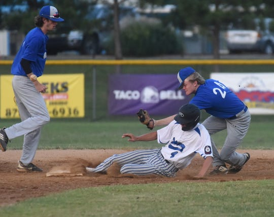 Lockeroom's Chase Orf slides into second base past the attempted tag of Harrison second baseman Teagen James on Friday night at Cooper Park.