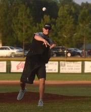 New Mountain Home High School assistant football coach Ryan Mallett throws out the first pitch before Friday night's Lockeroom vs. Harrison game.