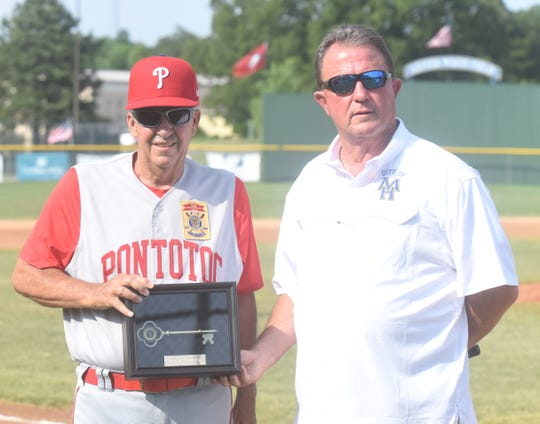 Pontotoc, Miss., head coach Nickey Browning is presented with a key to the city of Mountain Home by mayor Hillrey Adams before the Red Sox's game Friday night at Cooper Park.