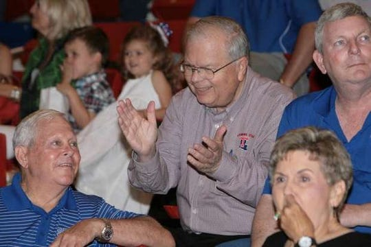 David Creed (center) cheers on the Louisiana Tech Lady Techsters from his perch inside the Thomas Assembly Center. Sitting with Creed are Steve Thurman (right), Charles Ashley (bottom left) and Carolyn Ashley (bottom right).