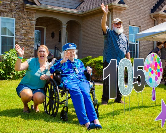 Mildred Gordon Harrison Roberts, seated, waves to well-wishers from a parade in honor of her 105th birthday on Saturday, June 20, 2020 in Murfreesboro. Also waving to the crowd are grandaughter Heather Eldridge and son Don Harrison.