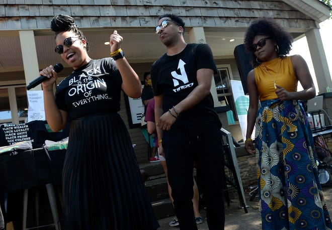 Karma Taylor, left, Nerlee, and Ashley Stewart of Writers' Block perform on Buchanan Street on Saturday, June 20, 2020 in Nashville, Tenn.  Events included the On the Rise business expo that featured 30 small Black businesses and a block party held by The Equity Alliance with an emphasis on a voter registration.