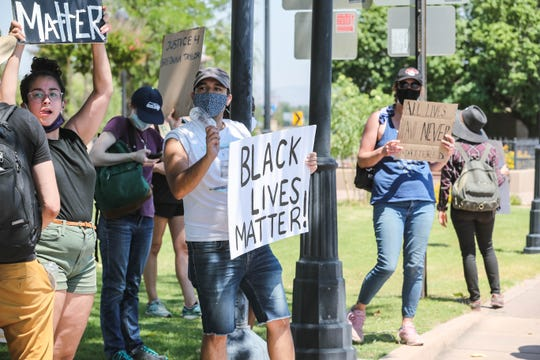 Protesters, speaking out against police brutality, march three miles from the Plaza de Las Cruces to the Mesilla Plaza on Saturday, June 20, 2020.