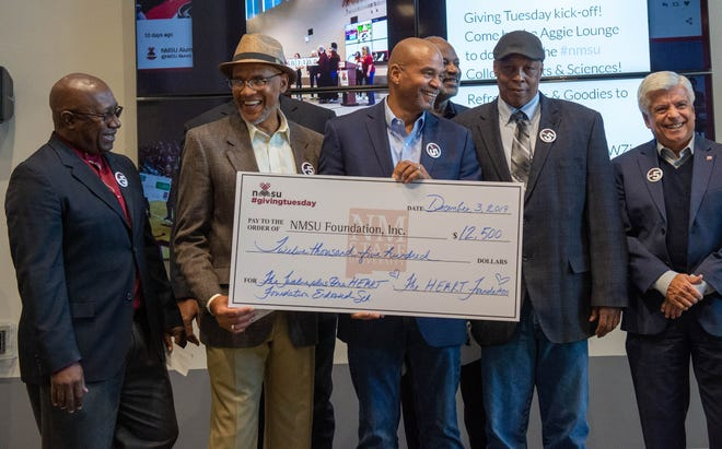 Members of the Twelve Plus One Heart Foundation present a check at New Mexico State University's Giving Tuesday 2019 to establish the Twelve Plus One Heart Foundation Endowed Scholarship. As of March 2020, the foundation is fully funded.