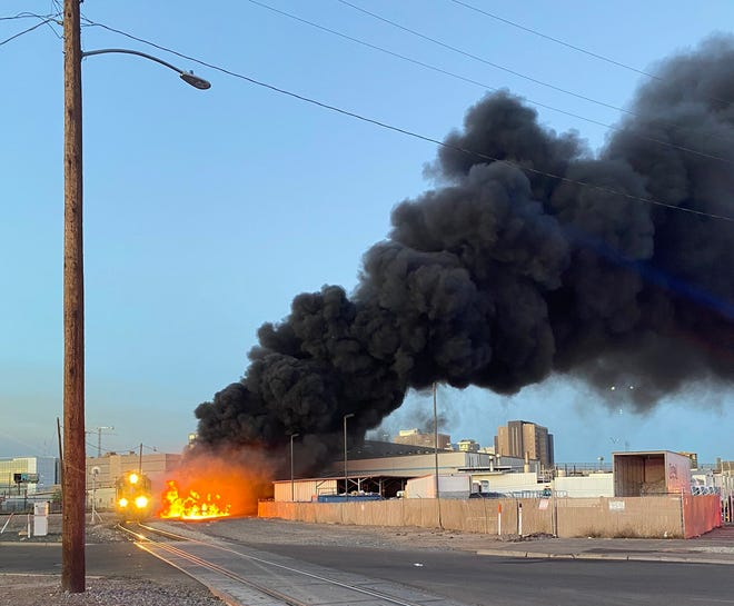 Officials say at least four rail cars caught fire near Ninth Avenue and Buchanan Street in Phoenix on June 19, 2020.