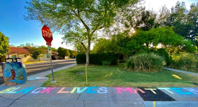 """The """"Black Lives Matter"""" message was painted in rainbow colors outside of a home in north Tempe."""