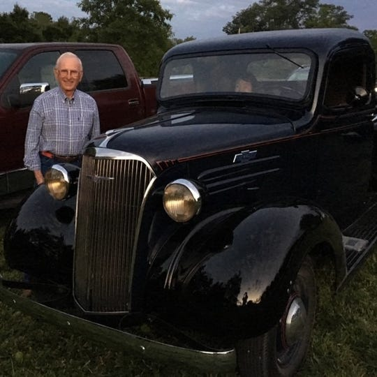 Bob Kinsley with an antique automobile.