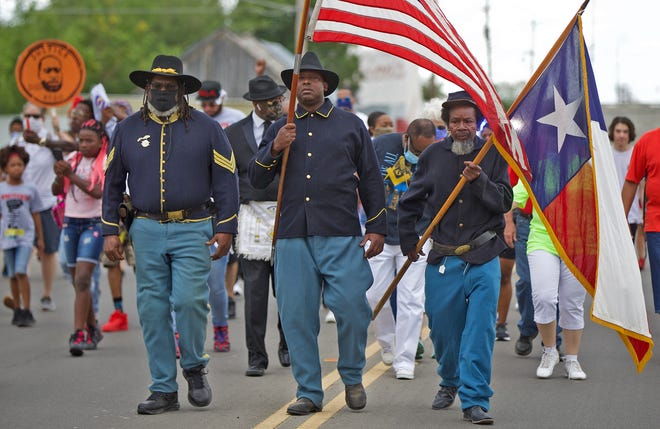 From left: Paul Cook, Daryl Jackson and Willie D. Bowman lead the march down Martin Luther King Drive in San Angelo in honor of the Juneteenth holiday on Saturday, June 20, 2020.