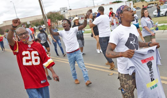 People march down Martin Luther King Drive in San Angelo to commemorate the Juneteenth holiday on Saturday, June 20, 2020.
