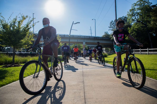 Dads and father figures gathered at Lake Anita with their families Saturday morning, June 20, 2020, for Tallahassee's Inaugural Father's Day Bike Ride.Ê