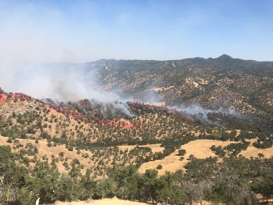 Crews work to battle the 200-acre Spring Fire in southeastern Tulare County on Saturday, the first day of summer. The CAL FIRE Tulare unit reports a busy start to the fire season.