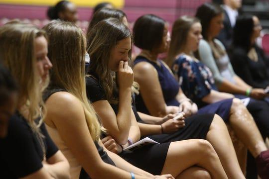Junior Haevyn Risley wipes away tears at the memorial service for women's basketball coach Noel Johnson, in D.L. Ligon Coliseum, Saturday, June 20, 2020. Johnson died of ovarian cancer June 9, 2020.